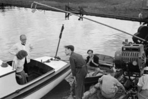 gordon-harker-standing-in-boat